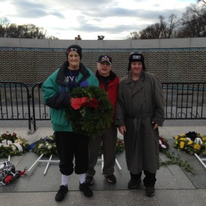 Joy and David Hendrix pose for a photo with Larry Dwyer while visiting the WWII Memorial.