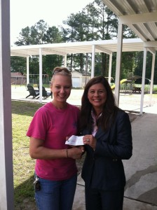 Julie Hathway presents check to Old Dock Elementary School principal Ronna Gore